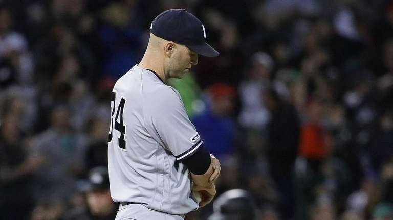 Starting pitcher J.A. Happ of the Yankees reacts