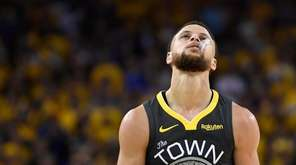 Golden State Warriors guard Stephen Curry reacts after