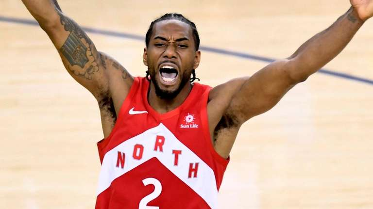 The Raptors' Kawhi Leonard celebrates after the buzzer
