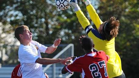Half Hollow Hills East goalkeeper Jordan Gross makes