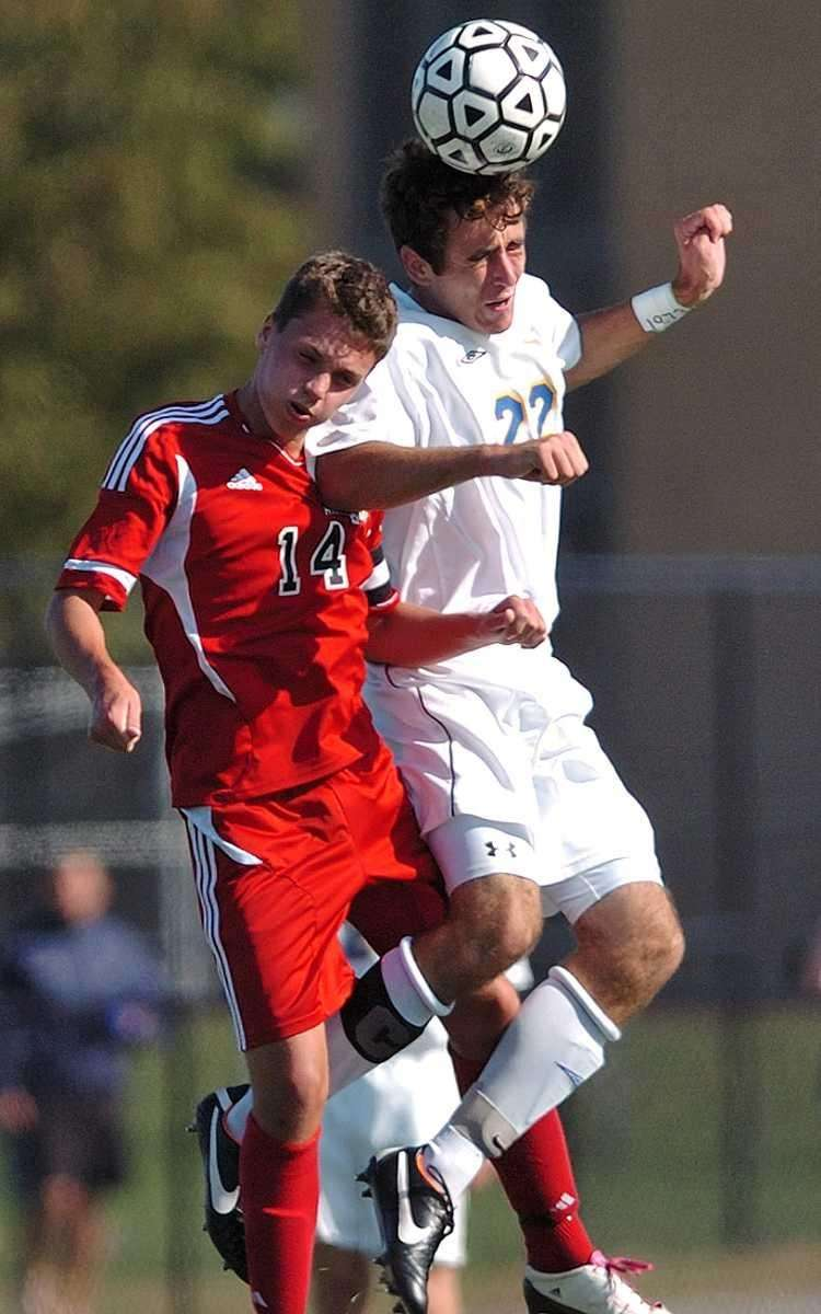 West Islip defender #22 Matt Bellucci, right, heads