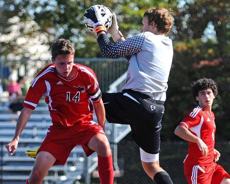 West Islip goalkeeper Sean McAllister makes a leaping