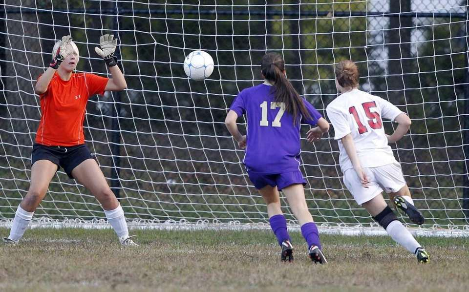 Sayville keeper Olivia Coley-Bishop follows the shot by