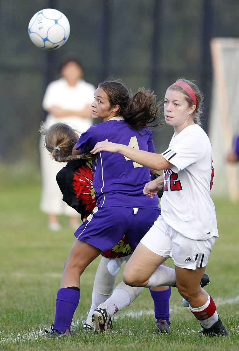 Sayville's Madison Hoon (4) directs the ball at