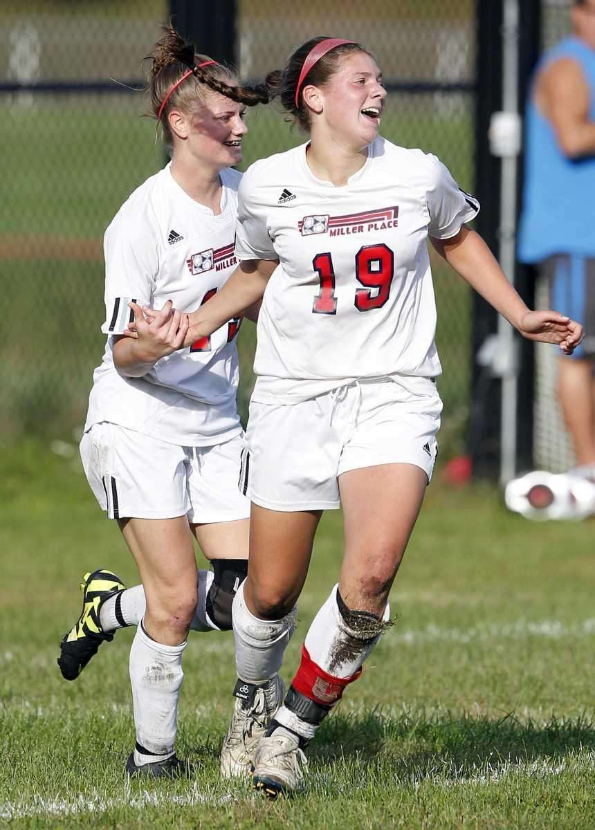 Miller Place's Kayla Ceschini (19) is congratulated by