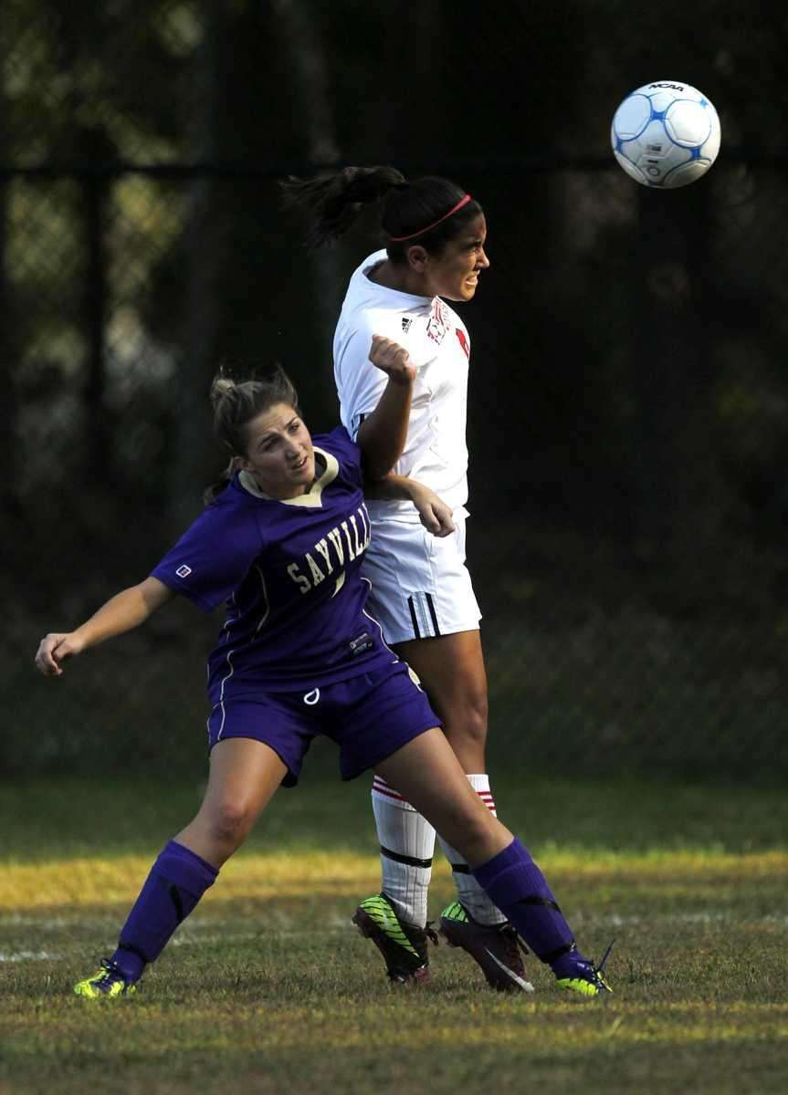 Miller Place's Hailey Bynon (8) wins the header