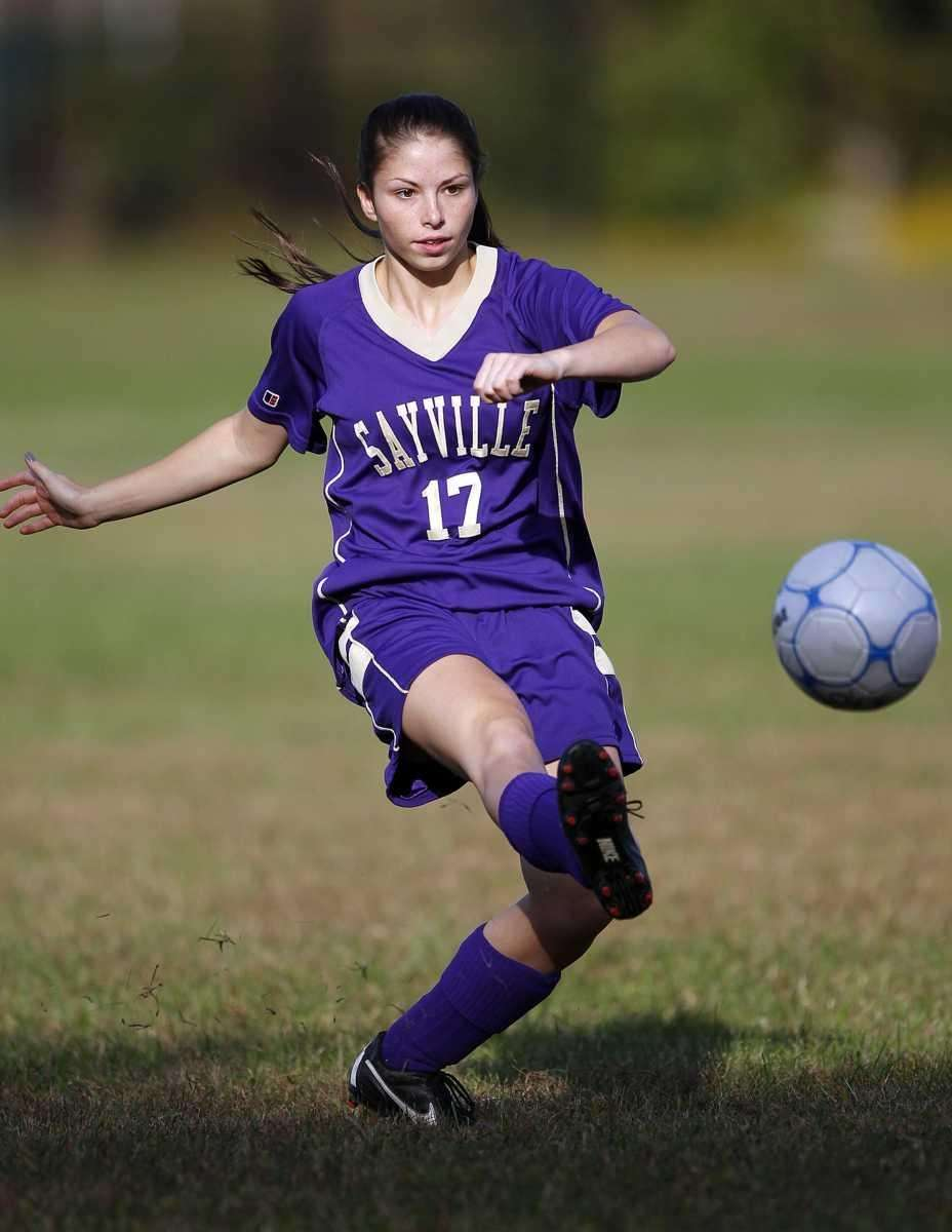 Sayville's Caroline DeLuca (17) feeds the ball upfield