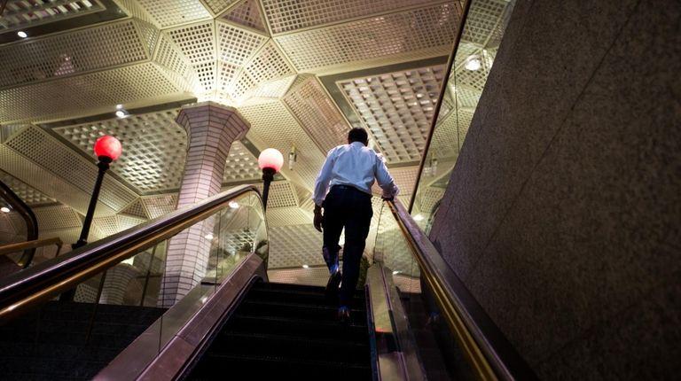 A man at the Wall Street subway station