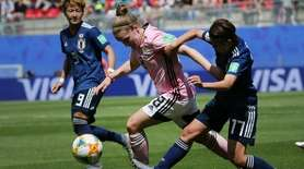 Scotland's Kim Little, center, vies for the ball