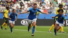 Italy's Cristiana Girelli, center, celebrates after scoring her