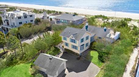 This 5-bedroom, 3 1/2-bathroom Quogue property sits on