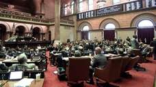 Members of the State Assembly vote on legislation