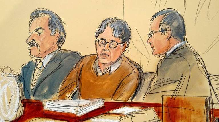 Defendant Keith Raniere seated between his attorneys Paul