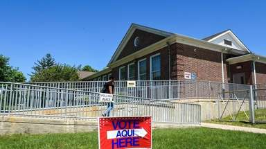 A voter leaves the Wyandanch school district's Central