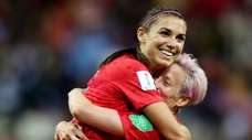 Alex Morgan, left, of the U.S. celebrates a