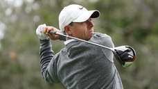 Rory McIlroy of Northern Ireland plays a shot