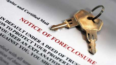 House keys and foreclosure notice.