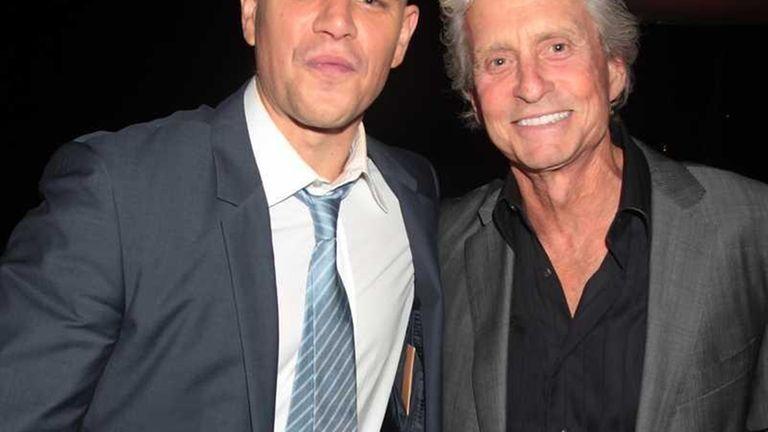 Actors Matt Damon, left, and Michael Douglas are