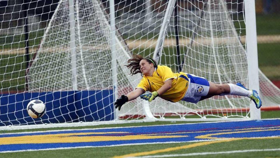 West Islip goal keeper Kelsey Ohman completely lays