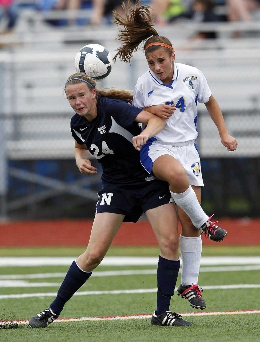 West Islip's Nicole Crofton (34) heads the ball