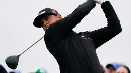 Gary Woodland watches his tee shot on the