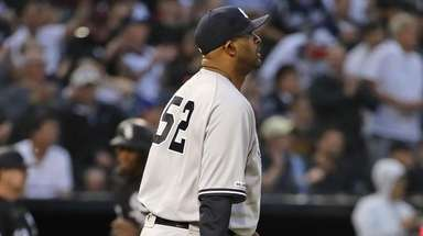CC Sabathia of the Yankees reacts after giving