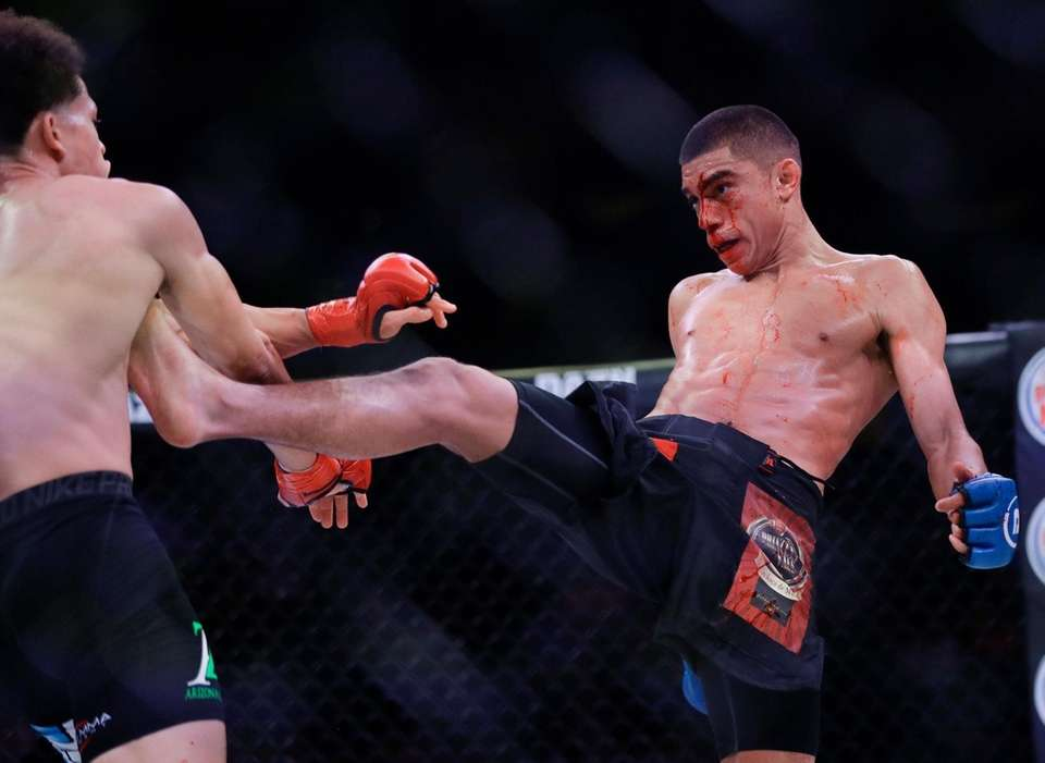 Sebastian Ruiz, right, kicks Mike Kimbel during the