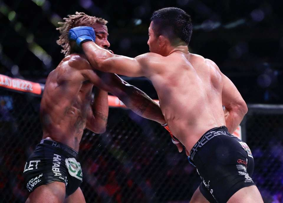 Japan's Kyoji Horiguchi, right, punches Darrion Caldwell during
