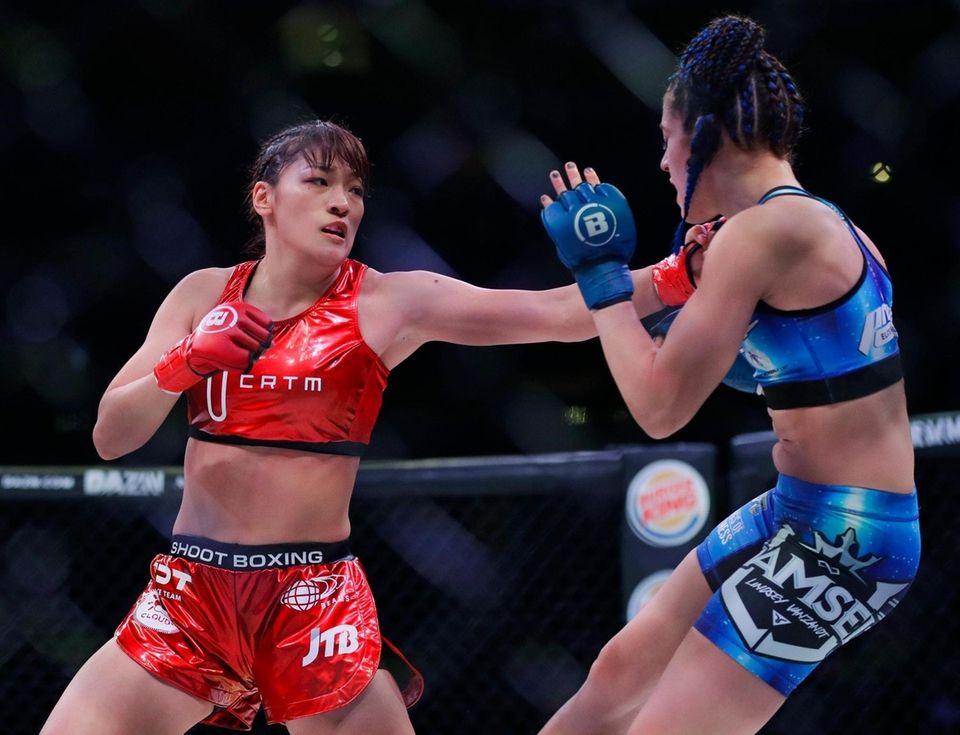Japan's Rena Kubota, left, punches Lindsay VanZandt during