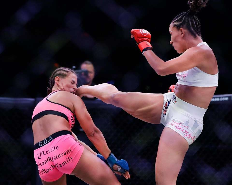Valerie Loureda, right, kicks Larkyn Dasch during the