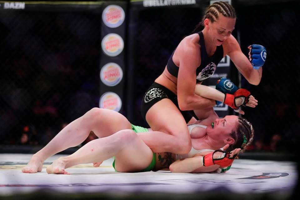 Taylor Turner, above, punches Heather Hardy during the