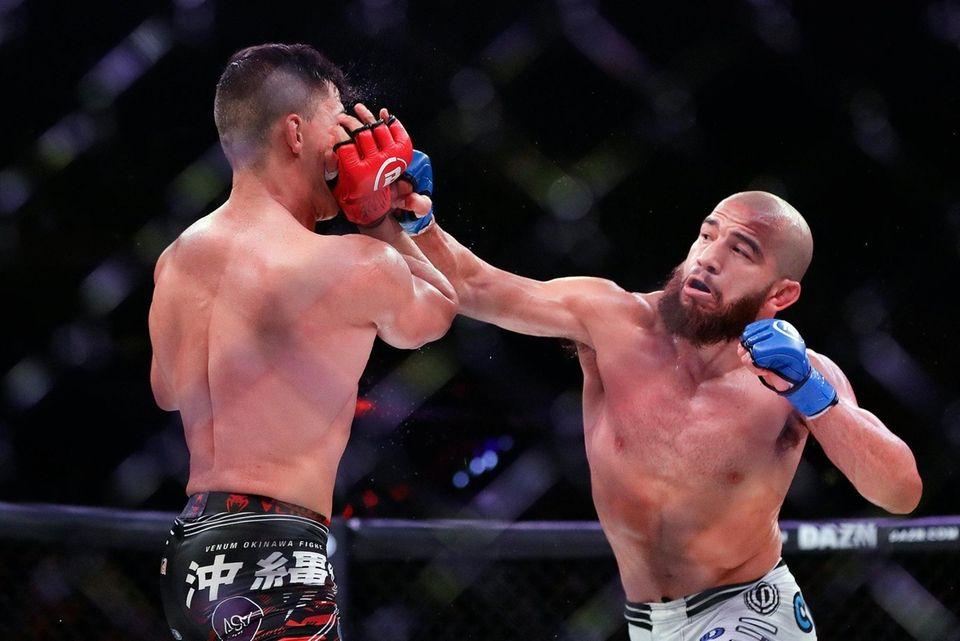 Juan Archuleta, right, punches Brazil's Eduardo Dantas during