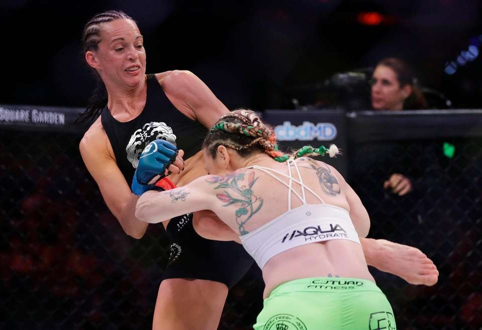 Taylor Turner, left, kicks Heather Hardy during the