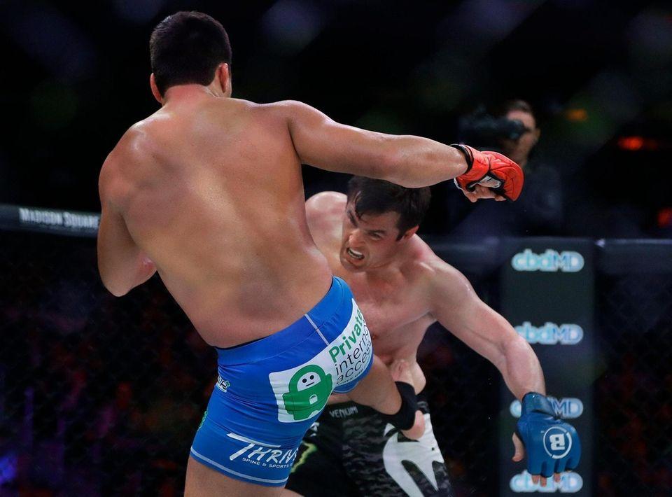Brazil's Lyoto Machida, left, kicks Chael Sonnen during