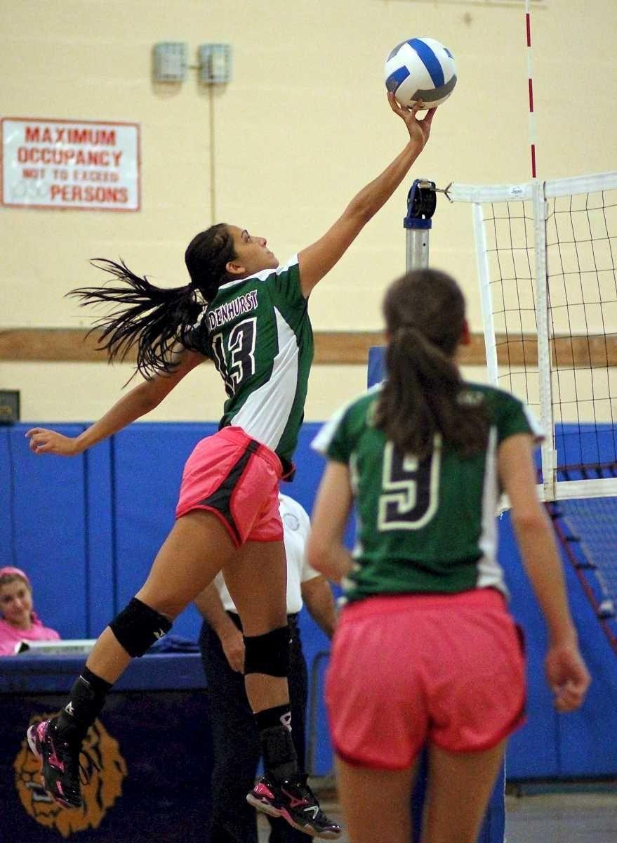 Lindenhurst's Alyssa Marchino #13 taps the ball over