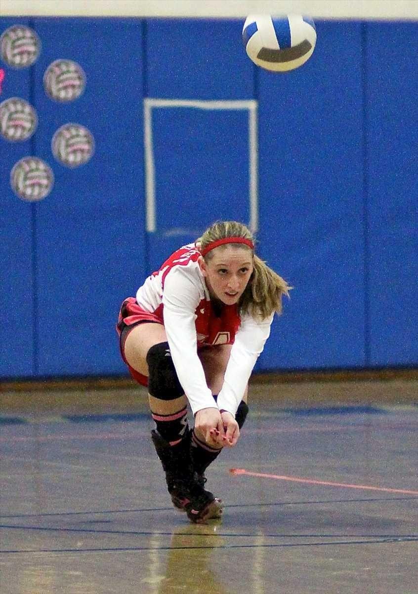 Lindenhurst libero Kayla Morgan #14, digs the shot
