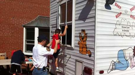 A child exits a safety house helped by