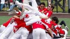 Center Moriches' Dylan Bryant and teammates celebrate after