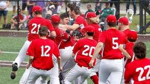 Center Moriches celebrates after defeating Schuylerville in the
