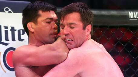 Lyoto Machida, left, fights Chael Sonnen during Bellator