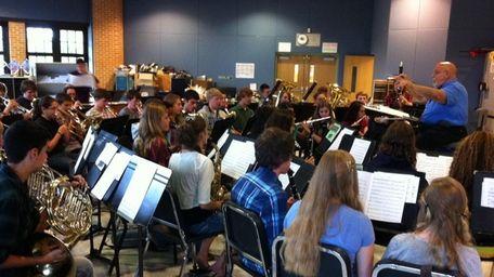 The Sayville High School wind ensemble rehearses songs