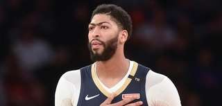 Pelicans forward Anthony Davis looks on in the