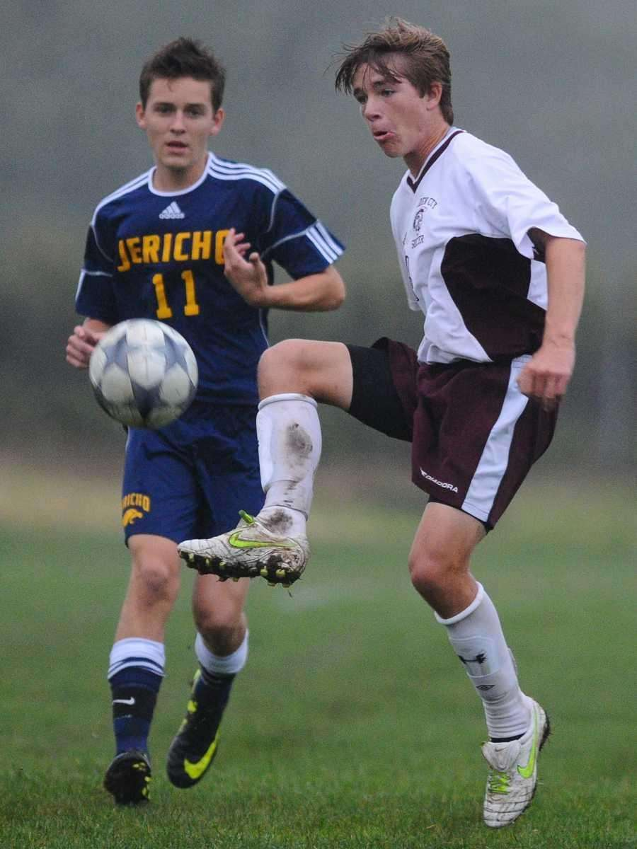 Jack Metzler, right, redirects a kick in front