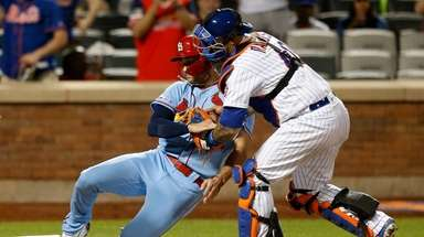 Wilson Ramos of the Mets tags out pinch-runner