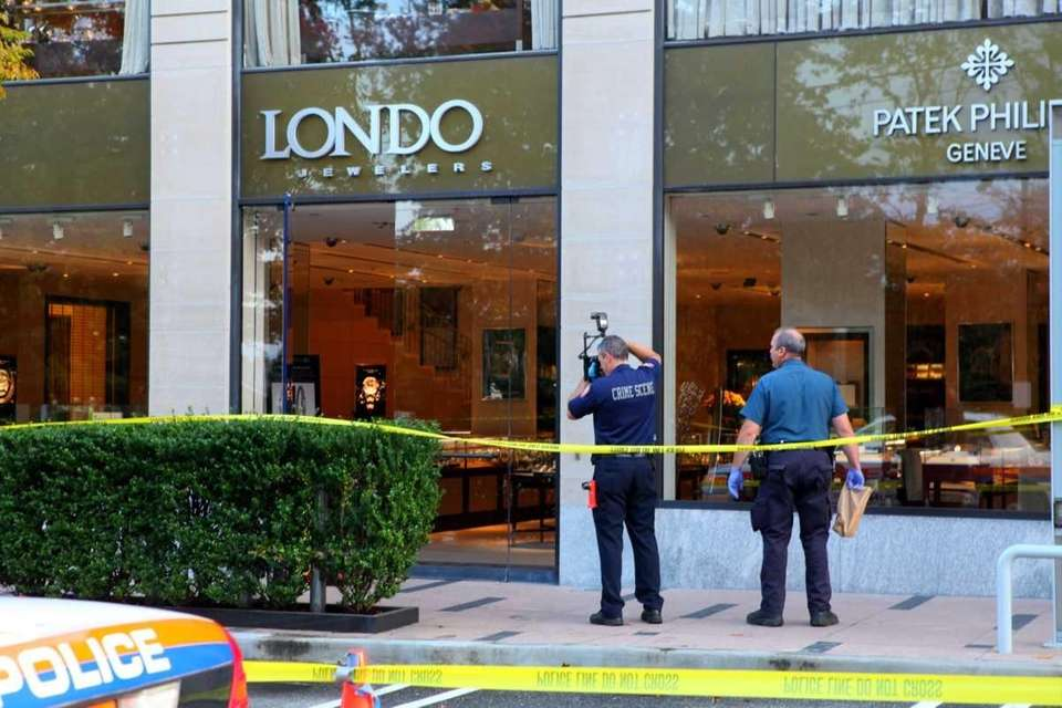 Police investigate the scene at London Jewelers in