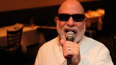 Vinny St. Marten, of Glen Cove, performs at