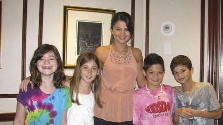 Actress Selena Gomez with Kidsday reporters, from left,