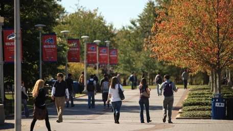 Students walk along the Academic Mall on the