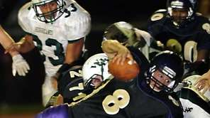 Islip's Joe Sabbatino's (8) extra effort gets the