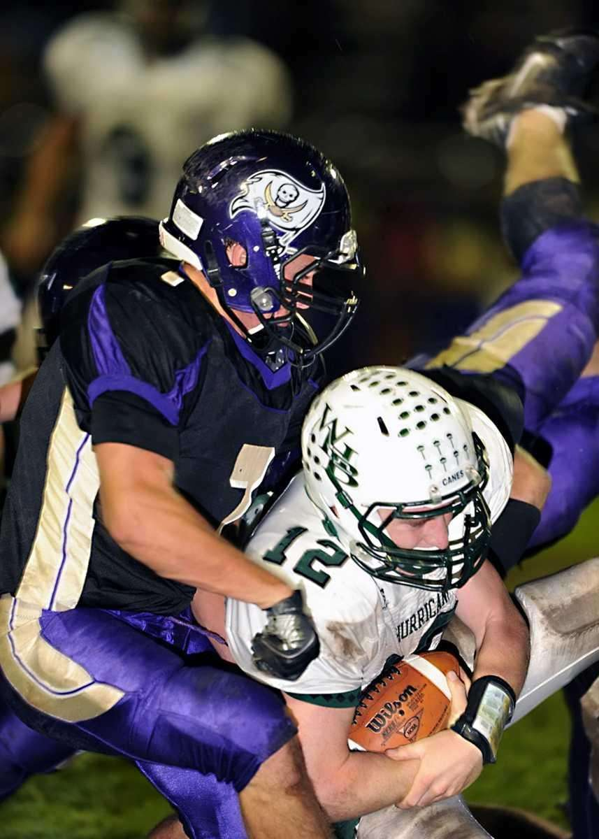 Islip's Travis Molin (7) puts a hard hit